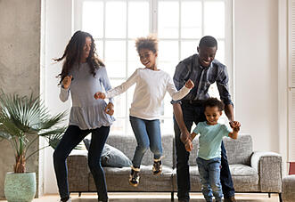 A family engages in a virtual day activity right in their living room.