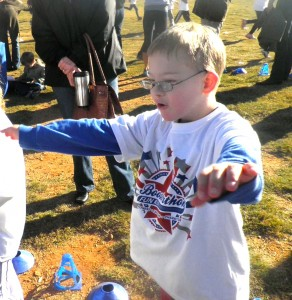 A young student wears his Boosterthon t-shirt at a Fun Run event.