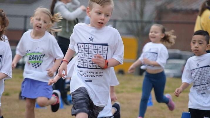 A group of children take the turn of a Boosterthon Fun Run.