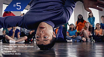 breakdancer spins as part of a Boosterthon media video.