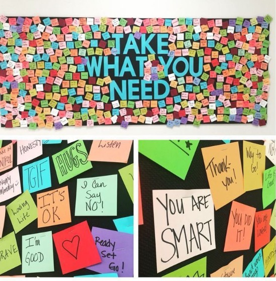 A wall of post-it notes saying cheerful messages.