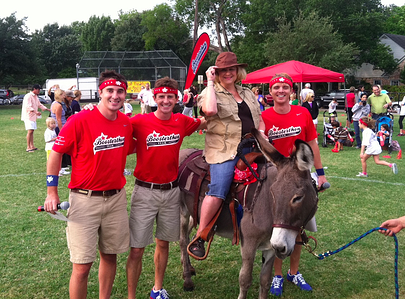The fun run donkey shows up at a Boosterthon event.