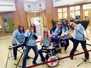 Mrs. Carter and a group of Meadow Glen teachers show their Rock'N Town Live enthusiasm to inspire students!