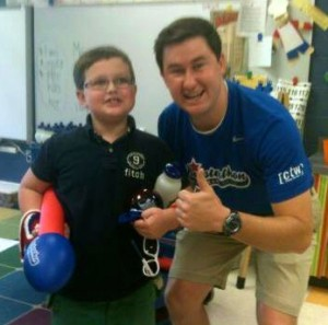 Booster team member posing with a student