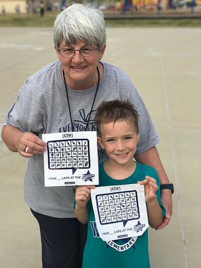 Young student Malachi with his teacher, Mrs. Scherer