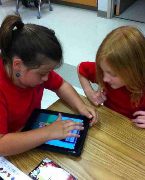 students from Lakeland elementary explorer on an iPad.