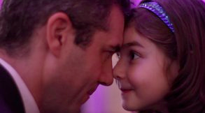 father and daughter dance together during a Boosterthon my princess dance.