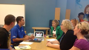 A Boosterthon organizer meets with faculty to discuss Boosterthon fundraising options.