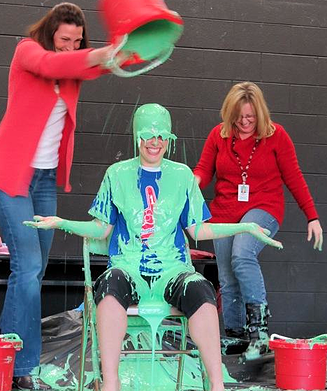 a teacher gets covered in green slime! It's all smiles.