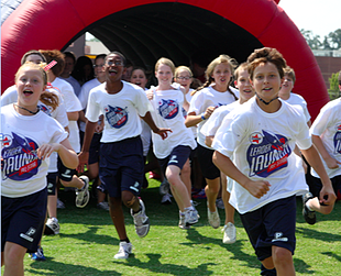 Students Running out of the tunnel during an event.