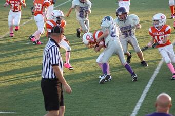 Trenten getting a tackle in football.
