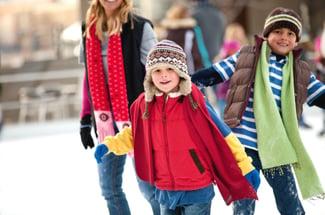 A family enjoys the winter snow.