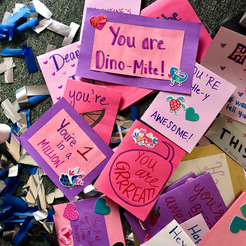 A pile of handwritten valentines cards made by Boosterthon team Indianapolis.