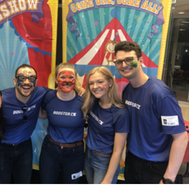 Boosterthon team Atlanta with painted faces at a children's healthcare event.