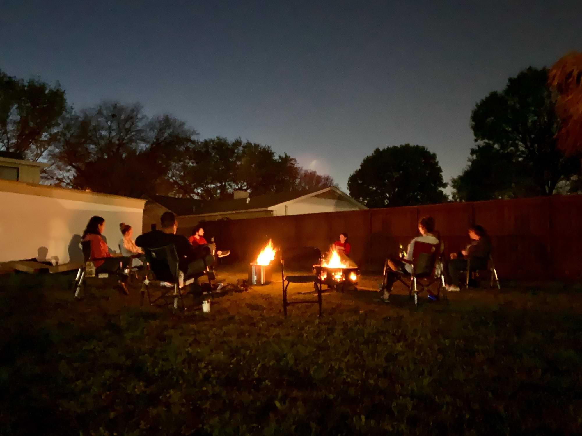 David and friends sitting around a campfire