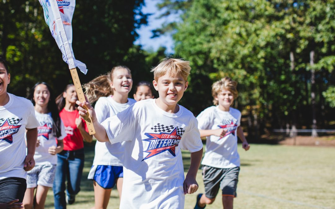 Students carry the Booster flag during a fun run!