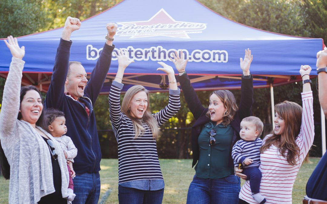 parents all cheer on at a Boosterthon event