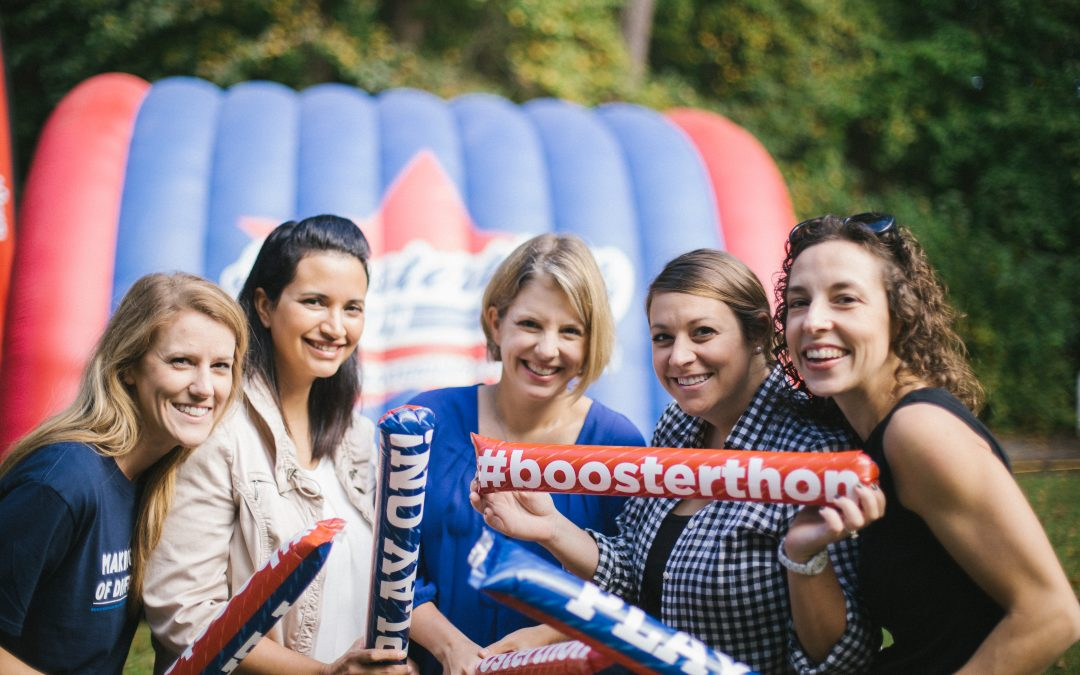 Group of mothers show off their Boosterthon cheering sticks